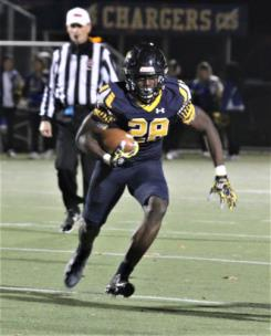 CCS's Traveon Scott finds running room Friday night as the Chargers win 42-10.