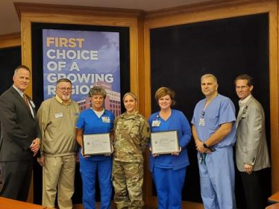 Pictured, from left to right, are: Dr. William Jackson, president and chief executive officer of Erlanger; Chris Cole, ESGR volunteer; Jennifer Ohle, Erlanger's perioperative director; Heidi Septor, RN; Annette Chapman, Erlanger's perioperative manager; Adam Royer, surgical services administrator at Erlanger; and Gregg Gentry, chief administrative officer at Erlanger
