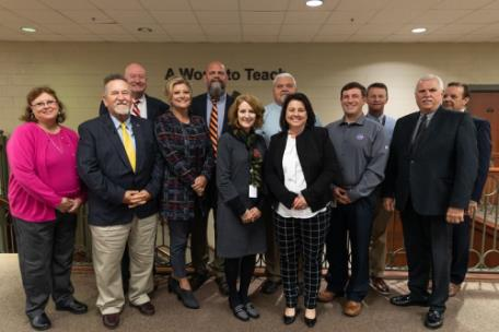 Local school superintendents and staff with Lee education professor Dr. Dan Lawson. Back row, from left, Dr. Lawson, Lee University; Dr. James Jones, Polk County schools; Jerry Levengood, Rhea County schools; Clint Baker, Meigs County schools; and Lee Parkinson, McMinn County schools. Front row, from left, Glenda Dykes, Grundy County schools; Dr. Mike Frazier, Etowah City schools; Dr. Melanie Miller, Athens City schools; Dr. Linda Cash, Bradley County schools; Dr. Sharon Harper, Tennessee Department of Education; Dr. Russell Dyer, Cleveland City schools; and Pete Swafford, Sequatchie County schools.