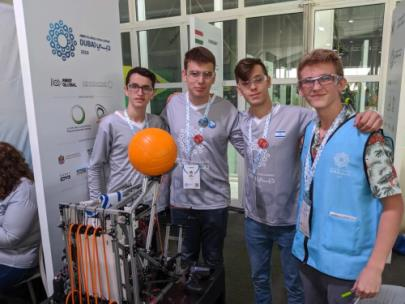 Jason, far right, is pictured with the robotics team from Israel