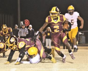 Tyner's Rashun Evans looks for running room Friday night in their second round playoff loss to Trousdale County.