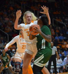 Emily Saunders towers over Stetson guard