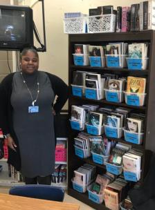 Ashley Cox, English department head at The Howard School with her classroom library funded by DonorsChoose