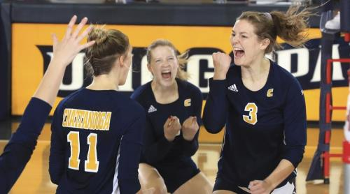 Dani Szczespansi, far right, celebrates with other members of the UTC volleyball team