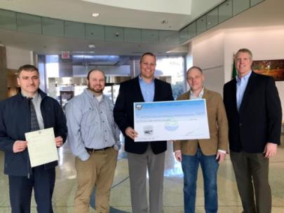 From left are Mo Minkara, Water Quality manager for the City of Chattanooga; Mike Hodges, project engineer for A.D. Engineering; Justin Holland, head of Department of Public Works; Ethan Collier, president and CEO of Collier Construction; and Adam Driver, president of A.D. Engineering