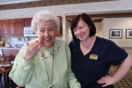 Morning Pointe of Collegedale at Greenbriar Cove resident Betsy Babb shows off the manicure given to her by resident assistant and trained cosmetologist Taylor Milliard
