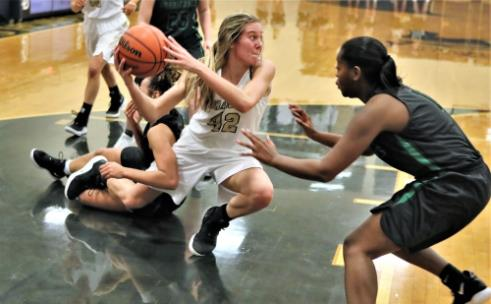 Bradley Central's Anna Walker looks to pass to a teammate while falling to the ground in Monday's District 5-3A tournament championship game against East Hamilton at Soddy-Daisy High School. Walker, the MVP, led the Bearettes to a 52-45 win and the team's ninth straight title.