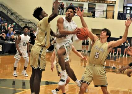 Cam Montgomery, center, shown in an earlier game, will be leading number one seed East Hamilton against number two Cleveland in the District 5-3A title game Tuesday night at Soddy Daisy High School. Also pictured are Bradley Central's Quante Berry, left, and Saylor Clark (5).