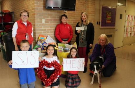Pictured, left to right, are: Principal Jamie Goodhard, Aidan Redner, Maria Fernandez, Austin Suggs, Brianna Taylor, 4th Grade Teacher Olivia Schoolfield and Kathy and Maggie from the HES