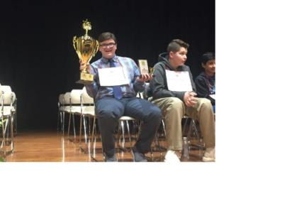 Connor Parks shows off his trophy after winning the Tennessee Regional Spelling Bee to qualify for the 2019 Scripps National Spelling Bee in May