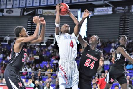 Laderron Freeman (4) of Brainerd puts up a shot between Pearl Cohn defenders Jamaal Ward, left, and Ciante Chaney (24) during a TSSAA Class 2A quarterfinal game Wednesday afternoon in Murfreesboro. Freeman rippled the nets for 16 points to help the Panthers to a 76-73 win over the Firebirds.