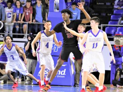 Four Cleveland players pay serious attention to Memphis East superstar James Wiseman -- from left, Isaiah Johnson, Dustin Bunton, Kley McGowan with his head in Wiseman's armpit and Grant Hurst during their Class 3A state tournament game at MTSU on Thursday. Wiseman, a 7-foot center, scored 20 points and grabbed 10 rebounds in a 77-51 victory that ended the Blue Raiders' season.