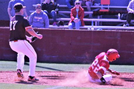 Ooltewah's Tyler Phillips (22), who drove in a run with a triple in the seventh inning against Grissom on Friday, scored moments later on a wild pitch. The Owls fell short of the Tigers, 7-2, in their own baseball invitational.