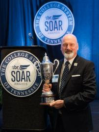 During the first Statewide Outstanding Achievement Recognition (SOAR) event held Wednesday night in Nashville, the College System of Tennessee honored Cleveland State as College of the Year taking home the gleaming new College Cup. Pictured is Dr. Bill Seymour, CSCC president, with the College of the Year College Cup award received at the SOAR Awards.