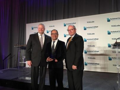 GNTC's Leyner Argueta (center) was named the 2019 Instructor of the Year for the Technical College System of Georgia. Also pictured is TCSG Commissioner Matt Arthur (left) and Pete McDonald (right), president of GNTC.