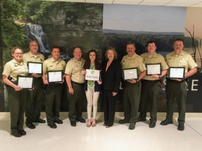From left are Robin Peeler, area manager; Kim Moore, area manager; Kenny Gragg, area manager; Mike Robertson, parks director; Kelsey Davis, environmental scientist for TDEC, Anne Marshall, acting deputy commissioner; Chris Padgett, area manager; Ryan Forbess, area manager; and Mike Dobis, area manager.