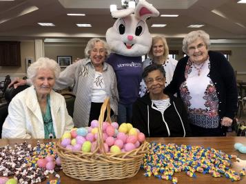 "Morning Pointe of Chattanooga residents Marguerite Vella, Sarah Stanley, Joanne Edwards, Barbara Burgess and Nancy Scruggs prepare for the assisted living community's annual Easter egg hunt with the help of their friend the Easter Bunny.  In addition to the massive egg hunt, which will span the entire Morning Pointe property and feature over 1,200 eggs, a large petting zoo will be set up in one of the building's courtyards. The Easter Bunny himself will be available for photos. ""We can't wait to meet all of the children and families who come to visit us,"" says Life Enrichment Director Holly Holcomb. ""It's going to be a spectacular time."""