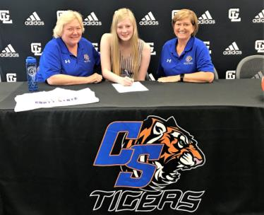Gordon Lee's Delaney Bridges, center, recently became the newest volleyball signee for Chattanooga State head coach Janet Tate, seated left. Also pictured is assistant coach Robin Moore.