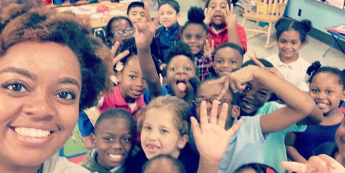 Woodmore Elementary School teacher Erica Richardson with students