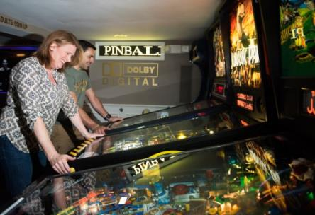 Harriet and Allan Chambers play pinball in the specail game room he built in their basement