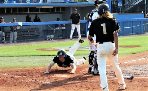 Bradley Central's Ryan Giovengo (1) watches as Tucker Still slides across home plate on Friday.  Both Bears scored on a throwing error, but Farragut went on to post a 7-3 victory and claim the Class 3A state baseball title.