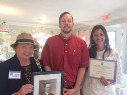 From left, Prudhomme Fort Chapter President Janet Cantrell, holds picture of Harry T. Burn; Tyler Boyd; and Emily W. Monroe with Certificate for Chapter Dame of the Year 2018.