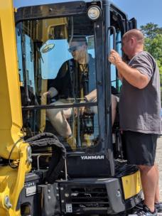 Tanner Moore, a student at Hixson High, and Jeremy Kaylor, instructor in the Natural Resources and Land Management program, review the operation of a piece of equipment at Chattanooga Tractor and Equipment