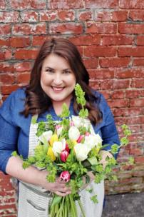 Katy Billings, owner of BloomHeart Flower Company, which opened its doors Monday