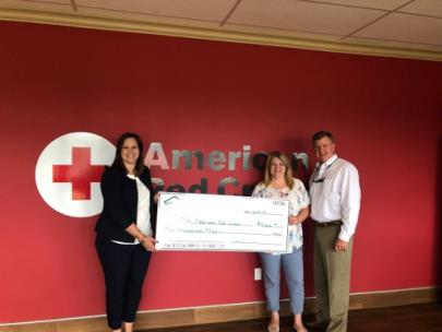 Julia Wright, executive director, of the Southeast Tennessee American Red Cross accepts a donation from Home Builders Association of Greater Chattanooga, represented by Cynthia Blackwell, director of Operations, and Doug Fisher, executive director.