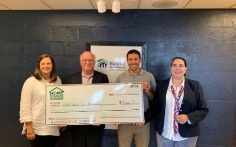 Cynthia Blackwell, director of Operations and Gabe Thomas, president of the Home Builders Association of Greater Chattanooga presents a donation to David Butler, CEO and Dominique Brandt, development director of Habitat for Humanity of Greater Chattanooga.