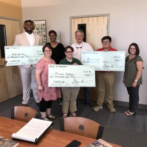 From left, the scholarship recipients with their mothers, Malcolm Key and mom, Frannie Hawkins and mom, Gary Highfield, and Micah Willard and mom