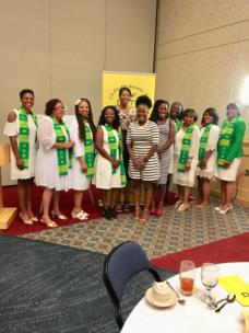 Pictured are Requel Tillson, Jeannie Atkinson, President Vonnie Stone, Grace Illesanmi, speaker, Dr. Love -England, scholarship recipients Melantha Cash and Mauriska Munroe, Gloria Halsell, Deborah Russell, Charquette Nelson and Mildred Geeter.