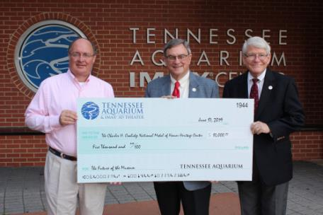 From left, Tennessee Aquarium President and CEO Keith Sanford; Maj. General Bill Raines, U.S. Army (Retired) MOHC Board of Trustees chair; Keith Hardison, MOHC executive director