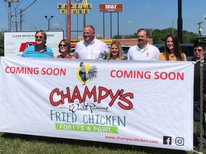 Pictured, left to right:  City Manager Chris Dorsey, Mandy Veazey, Champy's owners Seth and Crissy Champion, East Ridge Mayor Brian Williams, Delaney Steele and Israel Pardo