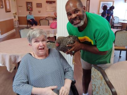 Resident Marilyn Selman with Dot the Dominique chicken, James Brantley