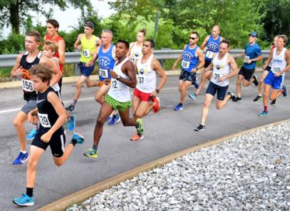 Runners at the Scenic City Scorcher race pass under the Veterans Bridge Saturday morning.