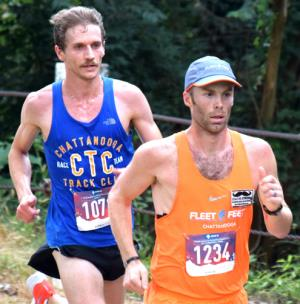 Christian Thompson, right, leads John Gilpin on the way to the finish. Gilpin won by 1/100th second.