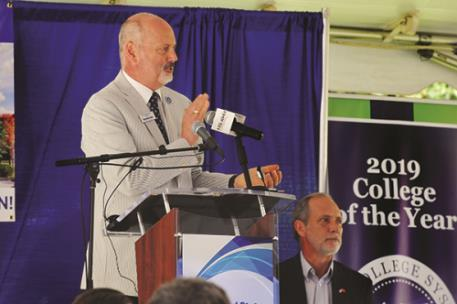 Dr. Bill Seymour welcomes the crowd at the CSCC Health & Science Center groundbreaking on Wednesday