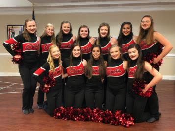 "Members of the Ooltewah High School Red Hots dance team strike a pose following a performance at Morning Pointe of Chattanooga at Shallowford. In addition to dancing for the assisted living community's residents, the award-winning dance team also enjoyed snacking and socializing with the seniors. ""The Red Hots reached out to me to plan an event together, as one of the girls has volunteered with me in the past,"" explains Morning Pointe life enrichment director Holly Holcomb. ""It was really touching to watch the girls find new friends in our residents. We would love to do more things to do together—the girls are already talking about Christmas plans!"""