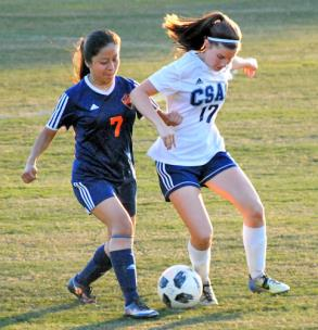 Jensen Ware of CSAS and Karla Paz of East Ridge fight for the ball.