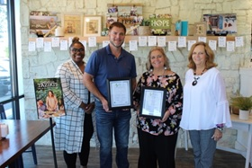 Taziki's Mediterranean Café Marketing Director Keytoya Brooks and local Owner/Operator Brad Emendorfer, shown holding BEST Partner certificates with Lisa Earby, principal for the Candy's Creek Cherokee Elementary School, and Sherry Crye, Chamber workforce development director