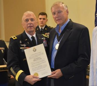 Dr. David Smartt, right, receiving the U.S. Army Order of St. Martin of Tours Chaplaincy Award