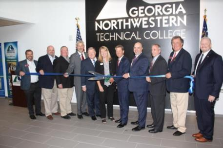 Pictured, from left to right: Representative Kasey Carpenter, Representative Steve Tarvin, TCSG State Board Member Randall Fox, State Senator Chuck Payne, TCSG State Board Member Joe Yarbrough, GNTC President Dr. Heidi Popham, Governor Brian P. Kemp, Representative Jason Ridley, Representative Matt Barton, Representative Rick Jasperse and TCSG Commissioner Matt Arthur.