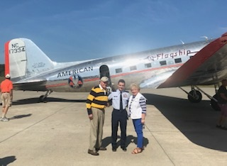 Cleveland Civil Air Patrol Lt. Col Nate Wilkie poses with Cleveland Emeritus Mayor Tom Rowland and wife Sandra as they depart Flagship Detroit, worlds oldest flying DC3