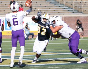 UTC's Telvin Jones puts pressure on James Madison quarterback Ben DiNucci Saturday afternoon in the Mocs 37-14 loss to the second ranked Dukes.