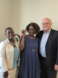 From left, Tenasa McGhee, new homeowner Vanester Steele and Dave Butler