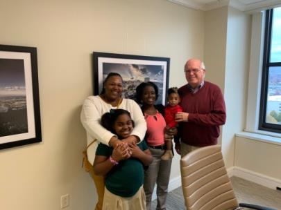 From left, new homeowner Tempestt Jordan, daughter Nikiah (6), Tenasa McGhee holding Tempestt's daughter Kada (1), and Dave Butler