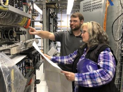 Noelle Currey and Josh Mabry, both UTC graduates, go over some of the testing programs for TVA's electrical equipment