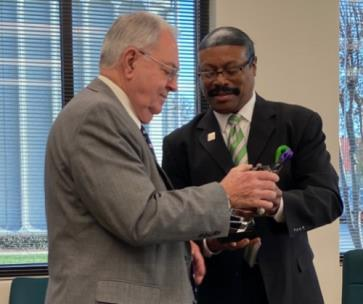 Hamilton County Emergency Communications District Board Chairman Dr. Richard Brown, right, presenting retired Board Chairman Don Allen with award in appreciation for 34 years of service to the district