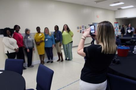 Abby Larry takes photos of the Rome-Floyd County Commission on Children and Youth's 31st Annual Luncheon. Ms. Larry works for the RFCCCY through the Youth Success Academy's Work Experience program at GNTC.